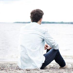 Man Sitting near river