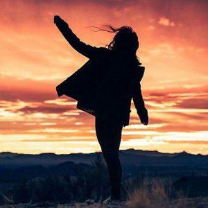 girl waving in evening dp